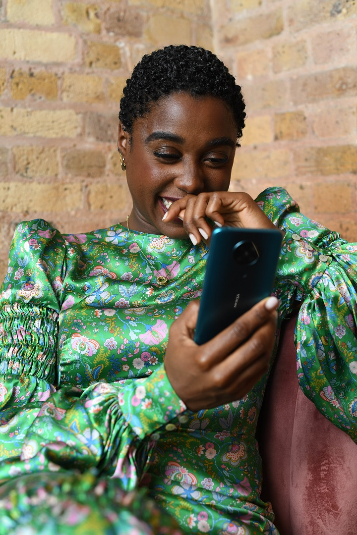No Time To Die Star -Lashana-Lynch with Nokia 5G phone