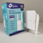 Tp-link AX1800 -Model_RE605X with the Box