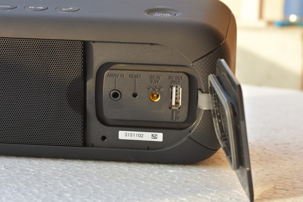 Sony XB40 wireless speaker -hidden panel with connectivity - 3.5mm, reset pinhole, DC charging pin and USB-A