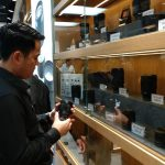 Sony Sales guy showing the lenses in the Kansas showroom